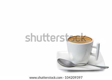 Espresso in a modern cup and a square saucer isolated over a white background.