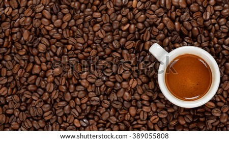 Espresso in a white cup on coffee beans - stock photo