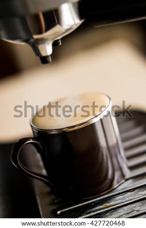 espresso machine pouring coffee to the espresso glass - stock photo