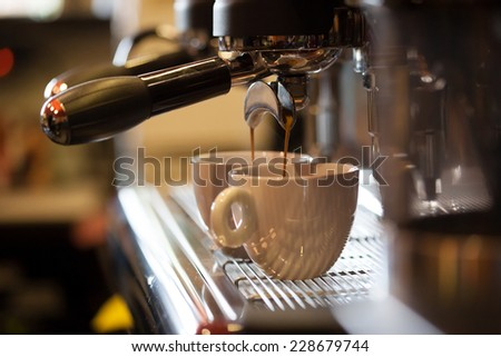 Espresso machine working with bar interior background - stock photo