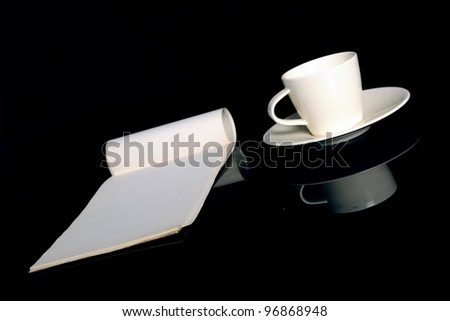 Espresso mug and a notepad - stock photo