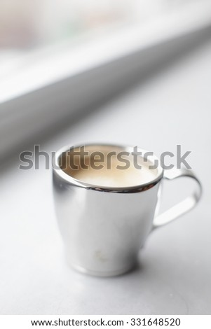 Espresso pouring into a cup - stock photo