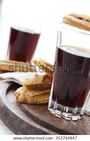 Espresso with butter cookies. black coffee with cookies.