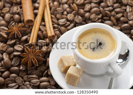 Espresso with coffee beans,  spoon and sugar - stock photo