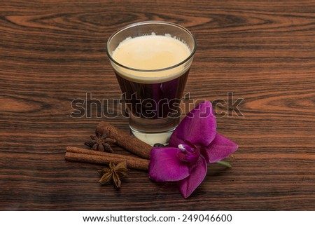 Espresso with orchid, beans, cinnamon, star-anise and cardamom - stock photo