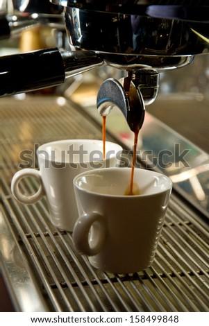 Espressos being made - stock photo