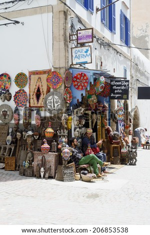 ESSAOUIRA, MOROCCO - MAY 14, 2014: Local artists selling their crafts in street on sunny day. Essaouira, Morocco. May 14, 2014. - stock photo