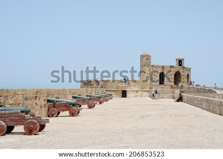 ESSAOUIRA, MOROCCO - May 14, 2014: Tourists walking and looking at historical fortress. Essaouira, Morocco. May 14, 2014.