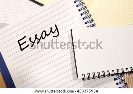 Essay text concept write on notebook - stock photo