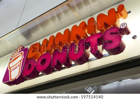 Essen, Germany - September 1, 2011: Dunkin' Donuts sign at shop entrance. Dunkin' Donuts is an international doughnut and coffee retailer founded in 1950, headquartered in Canton, Massachusetts. - stock photo
