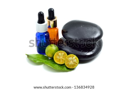 Essence oil and Zen stone with calamansi - stock photo