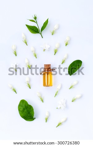 essential aroma oil with jasmine on white background - stock photo