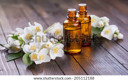 Essential aroma oil with jasmine  on wooden background. Selective focus. - stock photo