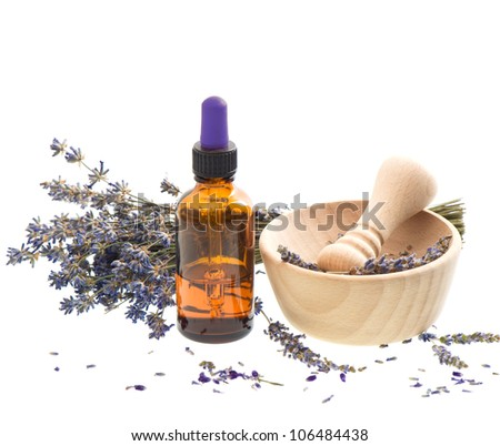 essential herbal lavender oil with dry flowers and mortar over white - stock photo