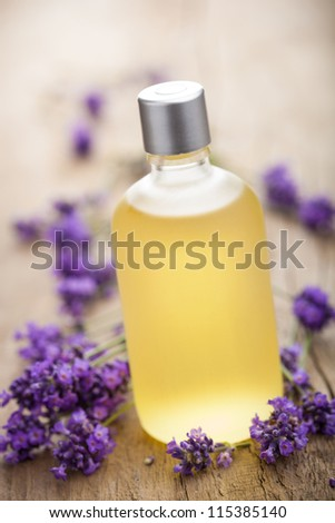 essential oil and lavender flowers - stock photo