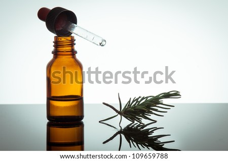 essential oil and rosemary - stock photo