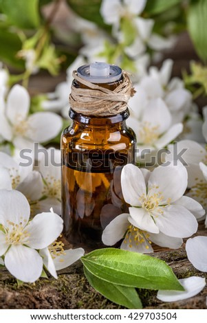 Essential oil made from jasmine on a rustic table