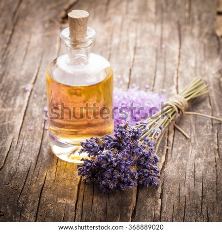 essential oil with lavender flower and seasalt - spa concept