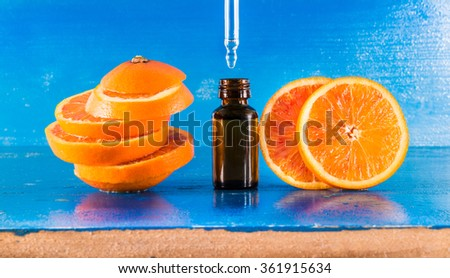 Essential oil with orange slices, bottle and dropper (horizontal)  - stock photo