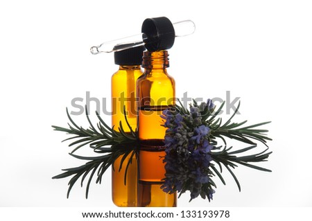 Essential oil with rosemary - stock photo