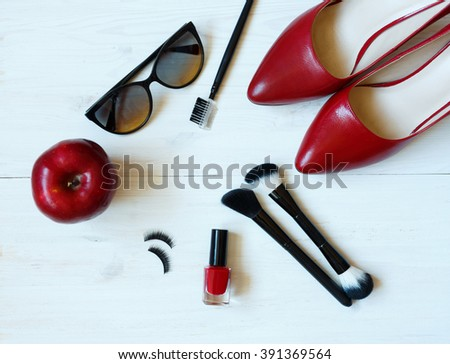 Essentials fashion woman objects on white wooden background - stock photo
