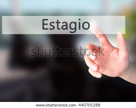 Estagio (Internship in Portuguese) - Hand pressing a button on blurred background concept . Business, technology, internet concept. Stock Photo