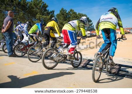ESTARREJA, PORTUGAL - MAY 16, 2015: Juvelines racing start during the Taca de Portugal Bmx. - stock photo