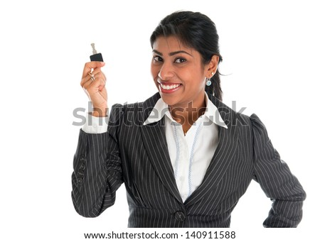 Estate agent. Happy Indian business woman or realtor showing keys. Isolated over white background.