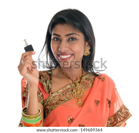 Estate agent. Happy Traditional Indian business woman or realtor showing keys. Isolated over white background. - stock photo