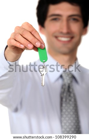 Estate agent with a key - stock photo