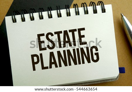 Estate planning memo written on a notebook with pen