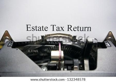 Estate tax return on typewriter - stock photo