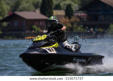 ESTAVAYER-LE-LAC, SWITZERLAND - JUL 06: Unidentified Speedring Jetski  Team Member performs trick during the 2013 Swatch Free4style Competition on July 06, 2013 in Estavayer, Switzerland.