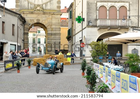ESTE (PD), ITALY - MAY 16: A light blue Bugatti T35A takes part to the 1000 Miglia classic car race on May 16, 2014 in Este. The car was built in 1926 - stock photo