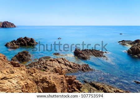 Esterel mediterranean red rocks coast and water sea in a long exposure seascape photography. Cote Azur near Cannes, Provence, France, Europe.