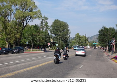 ESTES PARK, COLORADO - AUGUST 2015: Downtown motorcycle and car traffic in Estes Park