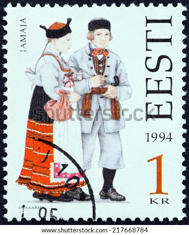"ESTONIA - CIRCA 1994: A stamp printed in Estonia from the "" Folk Costumes "" issue shows traditional clothing from Jamaja, circa 1994.  - stock photo"