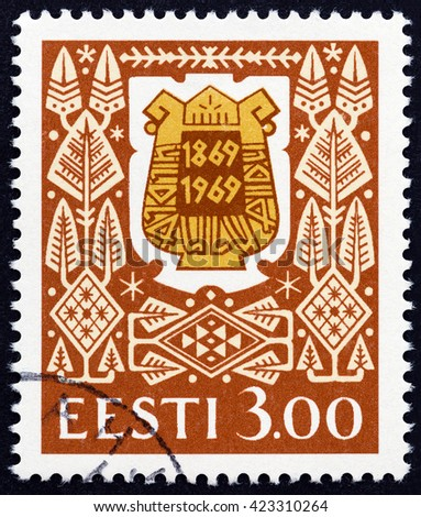 ESTONIA - CIRCA 1994: A stamp printed in Estonia issued for the 125th anniversary of Estonian Song Festival shows Song Festival Badge from 1969, circa 1994.  - stock photo