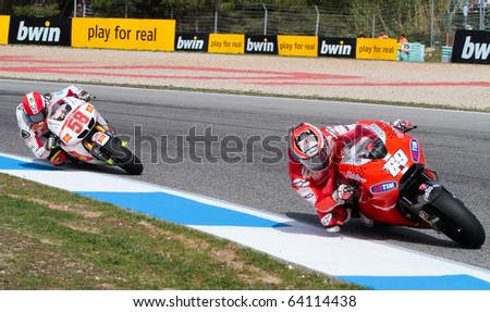 ESTORIL, PORTUGAL - OCTOBER 31 : Nicky Hayden (69) and Marco  Simoncelli (58) in Bwin MotoGP Portugal  2010 Race MotoGP  on October 31, 2010 in Estoril, Portugal - stock photo