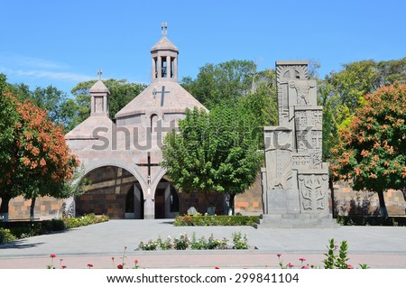 Etchmiadzin, Armenia, September, 16, 2014. Armenian scene: Nobody, Modern temple in the monastery of Etchmiadzin and khachkar in memory of the victims of the Armenian genocide of 1915 year