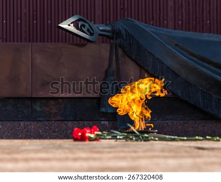 Eternal fire and flowers in memory of victims in the world war on victory day on 9 may, Grave of Unknown soldier, Kremlin wall. Moscow, Russia. - stock photo