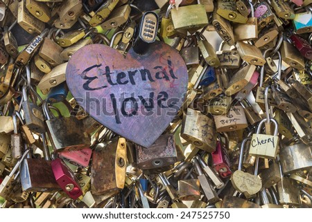 Eternal love padlock This love heart is a symbol of timeless affection  - stock photo