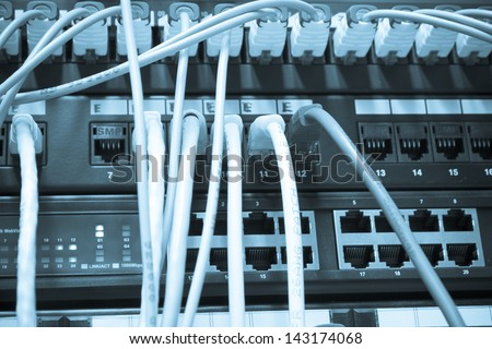 ethernet cables maze connected to switch - stock photo