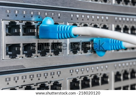 Ethernet interface ports of network equipment and cables - stock photo