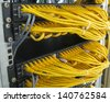 Ethernet RJ45 cables are connected to internet switch on business server network - stock photo