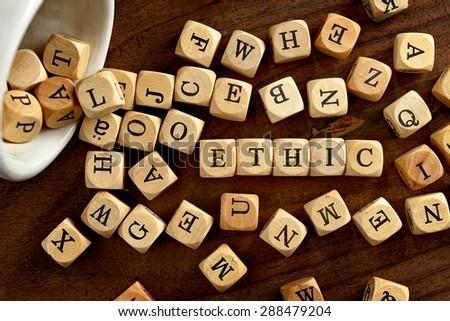 ETHIC word concept on wood blocks - stock photo