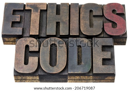 ethics code  - isolated words in vintage letterpress wood type with ink patina