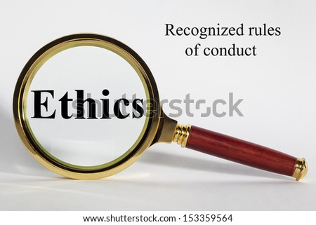 Ethics Concept - looking at Ethics through a magnifying glass. - stock photo