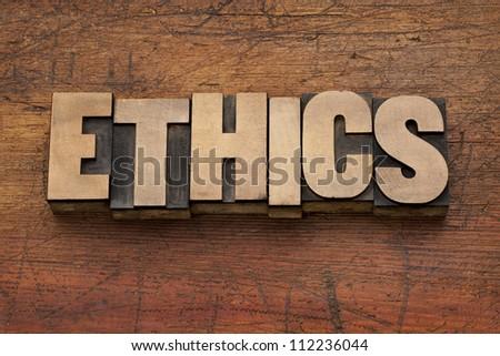 ethics word in vintage letterpress printing blocks against grunge wood background - stock photo