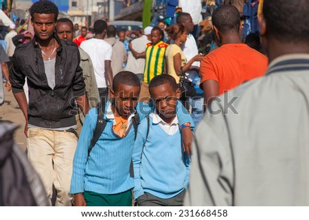 ETHIOPIA ADDIS ABABA DECEMBER 23,2013. Students in the street on Ethiopia Addis Ababa December 23,2013.  - stock photo